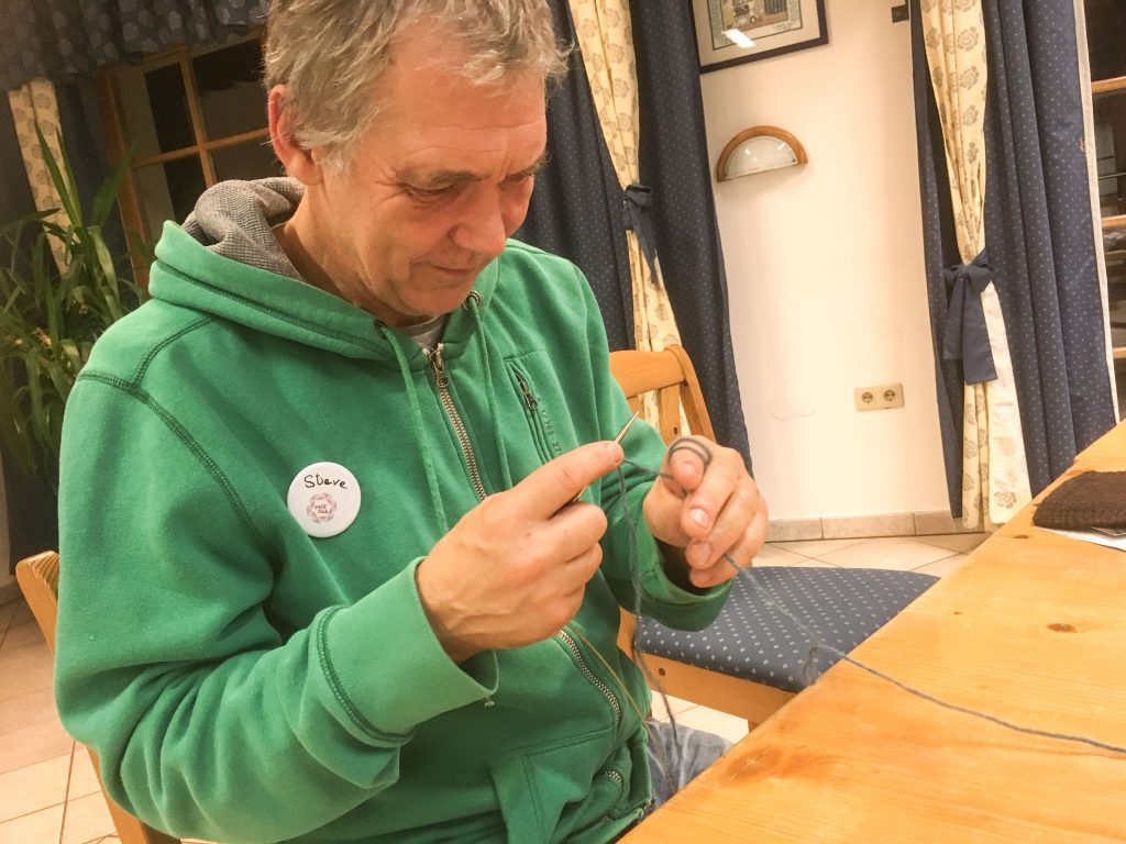 Steve learns to knit at Austrian Yarn Club Wollness Weekend